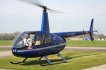 G-EVEV @ EGBR - Robinson R44 Raven ll at Breighton Airfield, April 2010. - by Malcolm Clarke
