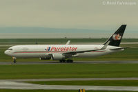 C-FGSJ @ CYVR - Taxiing to Purolator hanger after landing on north runway. - by Remi Farvacque