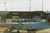 C-GMTA @ CYVR - Unloading at domestic - by Remi Farvacque
