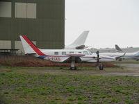 G-FCED @ EGHH - nice Cheyenne at hurn - hiding behind old AIM hangar - by magnaman
