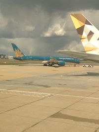 VN-A864 @ EGLL - on apron terminal 4 - taken from my seat on B-2736 as we parked up. - by magnaman