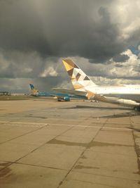 A6-APE @ EGLL - striking sun and colours at LHR - by magnaman