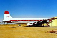 N4887C @ KL07 - Douglas DC-7B [45351] (International Air Response) Chandler-Memorial Airfield~N 17/10/1998