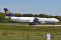 D-AIGT @ EDDF - Lufthansa A343 during its take-off run. - by FerryPNL