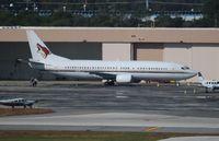 N129AC @ FLL - Phoenix Coyotes 737-400