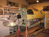 AR501 - Spitfire in workshop at Shuttleworth - by P Byers
