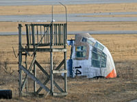 66-4299 @ KSCH - I found this interesting aeronautical artifact lying in a strange position at a remote corner of the airfield through my telephoto lens. - by Daniel L. Berek