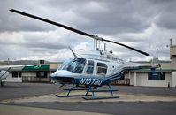 N1078Q @ KRHV - Aris Leasing Inc (Sunnyvale, CA) 1978 Bell 206B parked on the Nice Air helipads at Reid Hillview Airport, San Jose, CA. - by Chris Leipelt