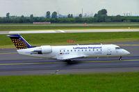 D-ACRI @ EDDL - Canadair CRJ-200-200LR [7862] (Lufthansa Regional/Eurowings) Dusseldorf~D 18/05/2006 - by Ray Barber