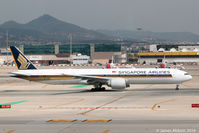 9V-SWH @ LEBL - Taxiing in Barcelona - by James Abbott