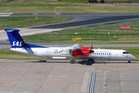 LN-RDD @ EGBB - De Havilland Canada DHC-8Q-402 Dash 8 [4009] (SAS Scandinavian Airlines) Birmingham Int'l~G 18/07/2006 - by Ray Barber