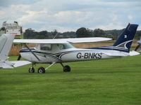 G-BNKS @ EGCV - club Cessna on grass - by magnaman