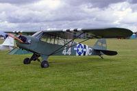 G-AJES @ EGDV - Piper J-3C-65 [11776] Hullavington~G 21/05/2005. Wears former military maks, - by Ray Barber