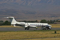 N550AA @ KCOD - Spotted from a long distance - by Glenn E. Chatfield