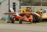 C-GXCS @ CYPZ - Parked by airport maintenance shed. Shot from Highway 16. - by Remi Farvacque