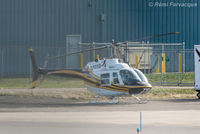 C-GYHL @ CYXS - Parked south of main terminal - by Remi Farvacque