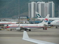 B-5100 @ VHHH - on crowded apron at HKG - by magnaman