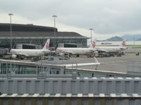 B-HTI @ VHHH - with two colleagues at HKG - by magnaman