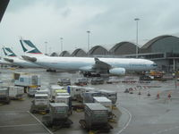 B-LBC @ VHHH - viewed from arrivals level at HKG - by magnaman