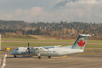 C-GSTA @ CYVR - Taxiing to domestic after eastward landing on north runway. - by Remi Farvacque