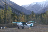 C-GMUD - On the tiny airstrip parallel to the Alaska Highway at the Northern Rockies Lodge, Muncho Lake, BC. - by Murray Lundberg