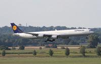D-AIHU @ EDDM - landing at munich airport - by olivier Cortot