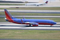 N500WR @ ATL - Southwest 737-800 that wears the former registration of retired NASCAR Driver Rusty Wallace's Lear.
