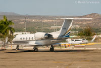 N77WL @ MMSD - Parked in executive jet area. - by Remi Farvacque