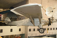 N211 - The original 'Spirit of St. Louis' under protective sheets in the Boeing Milestones of Flight Hall at the National Air and Space Museum. Charles Lindbergh took 33 hours 30 min. to cross the Atlantic solo from New York to Paris non-stop in May 1927.