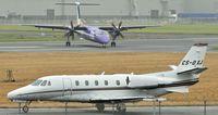 CS-DXJ @ EGAC - Awaiting departure as flybe G-PRPC arrives (background). - by Albert Bridge