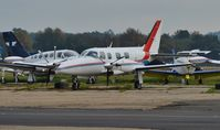G-FCED @ EGHH - Parked at Airtime - by John Coates