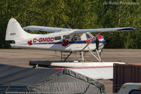 C-GMGD @ CYYE - Parked in front of private hanger, NE part of airport. - by Remi Farvacque