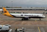 G-OZBE @ EGCC - Minute before docking at Manchester airport, gate 10. - by ikeharel