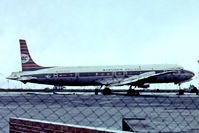 PH-DSO @ EGSS - Douglas DC-7C [45547] (Ex Martins Air Charter) Stansted~G 28/06/1975. From a slide. Taken through the fence.