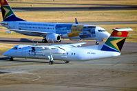 ZS-NMA @ FAJS - De Havilland Canada DHC-8-311 Dash 8 [358] (South African Express) Johannesburg Int~ZS 19/09/2006. Taken through the glass of the terminal.