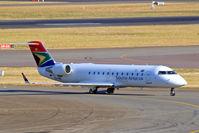 ZS-NMI @ FAJS - Canadair CRJ-200ER [7153] (South African Express) Johannesburg Int~ZS 19/09/2006. Taken through the glass of the terminal.