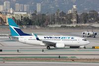 C-GWSU @ KLAX - Boeing 737-700 - by Mark Pasqualino