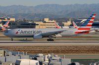 N787AL @ KLAX - American B772 vacating the runway. - by FerryPNL