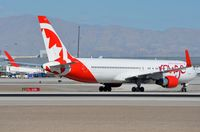 C-FIYA @ KLAS - Rouge B763 about to cross the runway. - by FerryPNL
