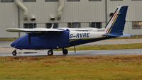 G-RVRE @ EGHH - Sat in the rain with its raincoat on - by John Coates