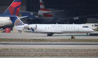 N963SW @ LAX - United Express