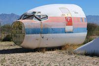 N9033U @ DMA - United 737-200 in boneyard