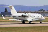 D-AAOK @ LFSB - Canadair Challenger 604, Reverse thrust landing rwy 15, Bâle-Mulhouse-Fribourg airport (LFSB-BSL) - by Yves-Q