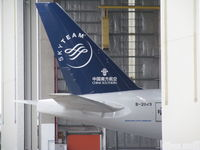 B-2049 @ NZAA - poking out of air NZ maintenance hangar - by magnaman