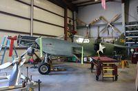 N40245 @ CNO - P-40E being restored