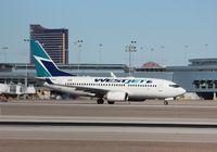C-FKWS @ KLAS - Boeing 737-700 - by Mark Pasqualino