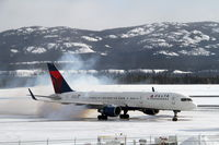 N6713Y @ CYXY - Firing the engines in Whitehorse, Yukon, Canada, at -23C after being diverted during an MSP-ANC flight the previous night due to oxygen problems. - by Murray Lundberg