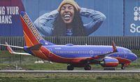 N235WN @ KOAK - North Field Oakland Airport - by Clayton Eddy