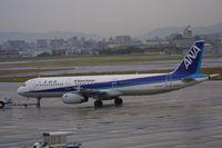 JA107A @ RJNA - At a rainy Nagoya Komaki airport - by lkuipers