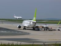 YL-BBK @ LFPG - Air Baltic at CDG terminal 1 - by Jean Goubet-FRENCHSKY